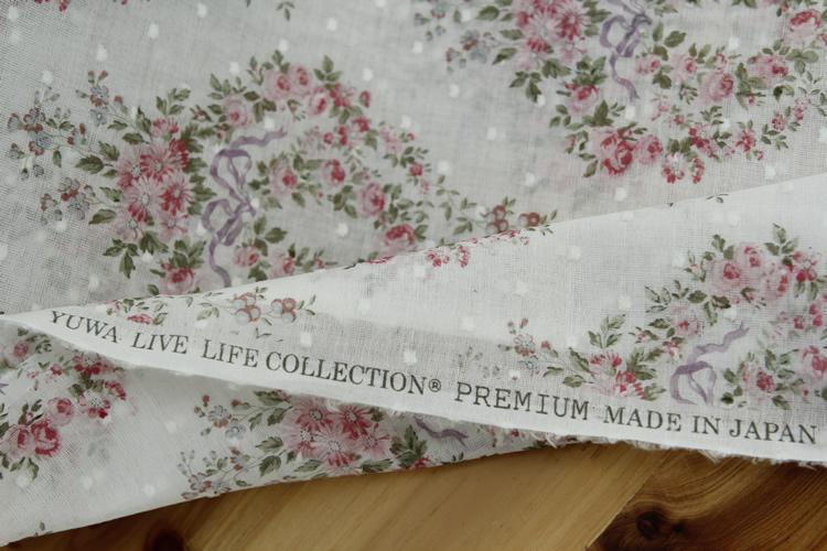 日本YUWA进口布料 蝴蝶结花团